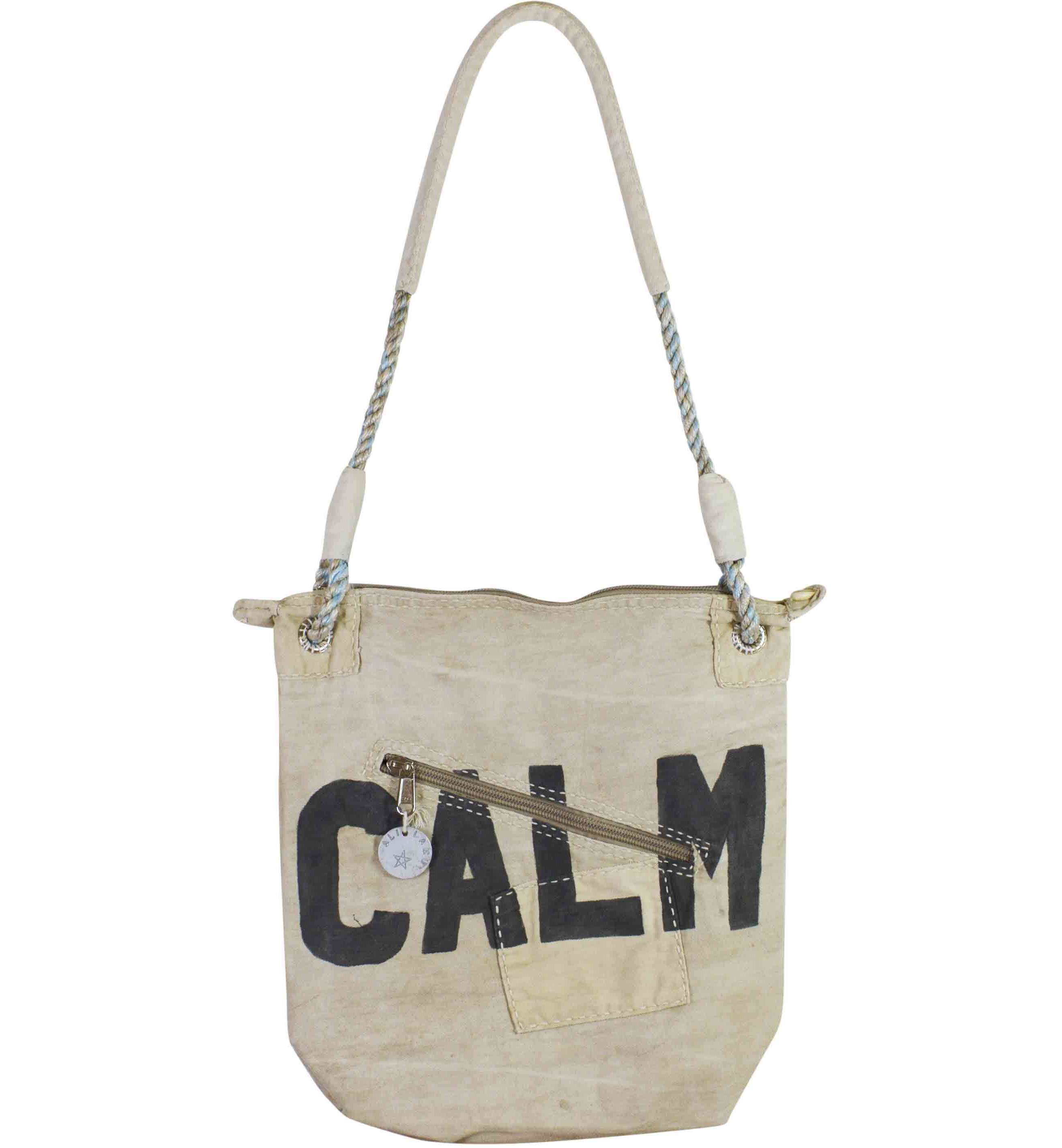 SKULDER TASKE. VINTAGE. NEUTRAL CANVAS. TEKST CALM